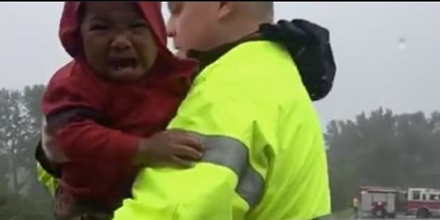 Police rescue a little boy in North Carolina.