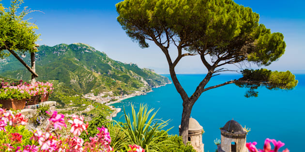 Scenic picture-postcard view of famous Amalfi Coast with Gulf of Salerno from Villa Rufolo gardens in Ravello, Campania, Italy.