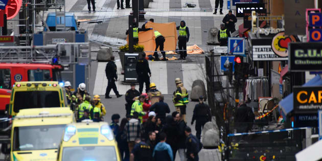 TOPSHOT - Emergency services work at the scene where a truck crashed into the Ahlens department store at Drottninggatan in central Stockholm, April 7, 2017.  / AFP PHOTO / Jonathan NACKSTRAND