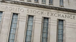 TSX Sets Record High But Loonie Loses Some