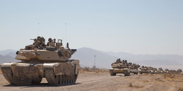 "Abrams tanks train in the desert for the possibility of ""decisive action."""