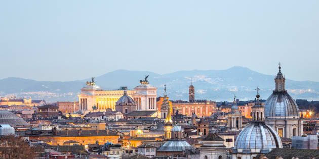 Roman citscape panorama at sunset in January, Rome Italy