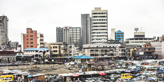 Parking lot and office buildings in Lagos Island's commercial district.