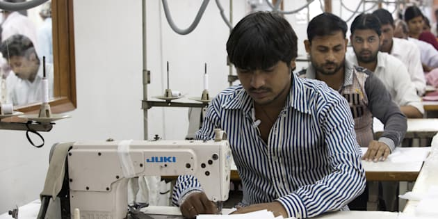 Labourers sew linens at the April Cornell clothing factory in Noida.