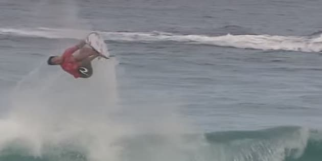 Gabriel Medina backflips on a wave and yes, he lands it.