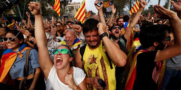 People celebrate after the Catalan regional parliament declares the independence from Spain in Barcelona, Spain, October 27, 2017. REUTERS/Juan Medina
