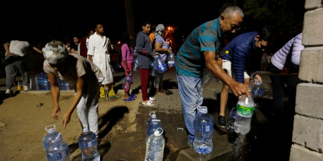 People queue to collect water from a spring in the Newlands suburb as fears over the city's water crisis grow in Cape Town. January 25, 2018.