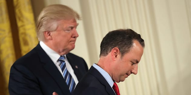 U.S. President Donald Trump congratulates White House Chief of Staff Reince Priebus during a swearing in ceremony for senior staff at the White House in Washington, D.C. January 22, 2017. (REUTERS/Carlos Barria)