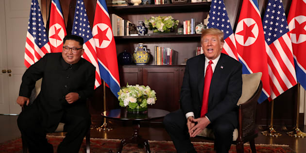 U.S. President Donald Trump sits next to North Korea's leader Kim Jong Un before their bilateral meeting at the Capella Hotel on Sentosa island in Singapore June 12, 2018. REUTERS/Jonathan Ernst