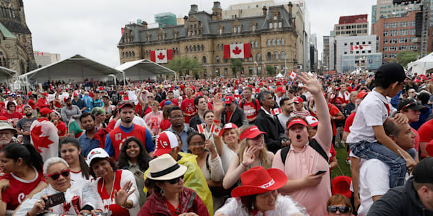 Crowds cheer during during Canada Day celebrations on Parliament Hill on July 1, 2017.