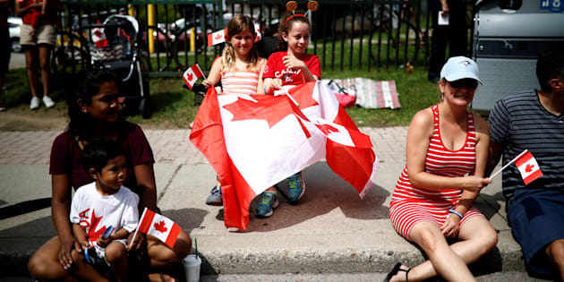 "People watch the East York Toronto Canada Day parade, as the country marks its 150th anniversary with ""Canada 150"" celebrations, in Toronto, Ontario, Canada July 1, 2017."