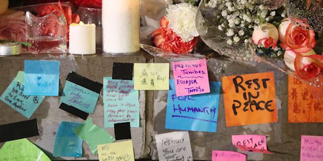 Messages on post-it notes sit in the rain April 24, 2018. A candlelight vigil is held at Olive Square near Yonge and Finch Streets for the 10 people that were killed and the 15 injured in the van attack along Yonge Street between Sheppard and Finch streets  in Toronto.