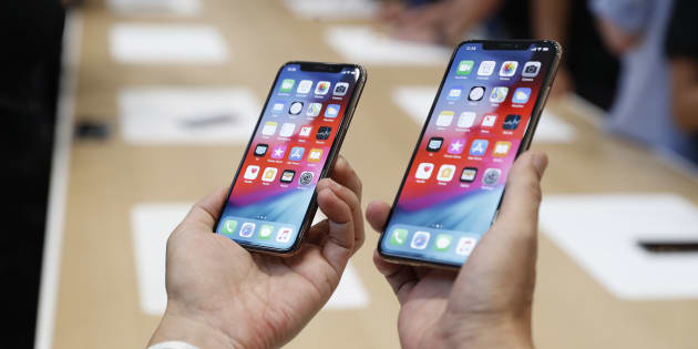 A man holds the newly released Apple iPhone XS and XS Max during a product demonstration following the Apple launch event at the Steve Jobs Theater in Cupertino, California on Sept. 12, 2018.