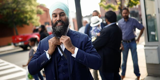 NDP leadership candidate Jagmeet Singh puts on his tie outside a meet and greet event in Hamilton, Ont. on  July 17, 2017.