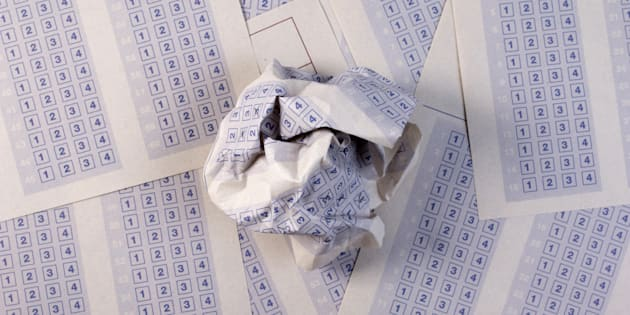 Crumpled paper ball on vintage classic answer sheet. Answer sheet concept.