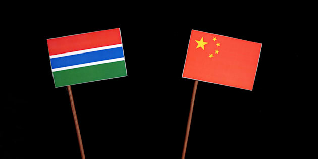 Gambian flag with Chinese flag isolated on black background