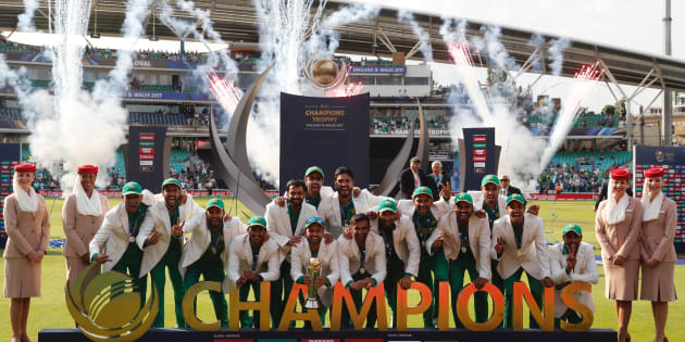 Pakistan players pose with the trophy as they celebrate their win at the presentation after the ICC Champions Trophy final cricket match between India and Pakistan at The Oval in London on June
