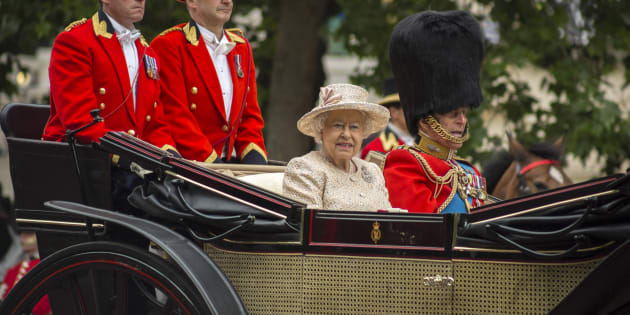 London, England - June 13, 2015: Queen Elizabeth II in an open carriage with Prince Philip for trooping the colour 2015 to mark the Queens official birthday, London, UK
