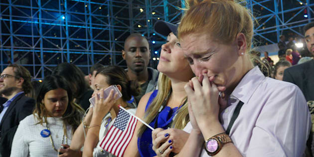 Democratic Party's presidential nominee Hillary Clinton's supporters show their sorrow as the results indicate the Republican Party's presidential nominee Donald Trump's victory for the 2016 Presidential Elections at Jacob K. Javits Convention Center in New York.