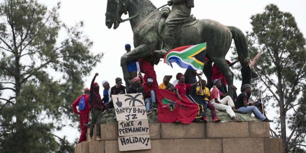 South African political party the E.F.F (Economic Freedom Fighters) supporters and other opposition activists gather in Pretoria, on April 12, 2017 ahead of a march calling for the ousting of the embattled President Jacob Zuma. President Jacob Zuma is facing pressure to step down following a controversial cabinet reshuffle and mass corruption charges.