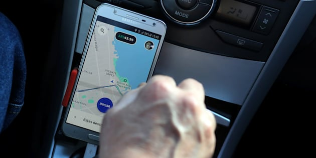 Uber driver Juan Carlos uses his application map on his cellphone as he drives his car in Buenos Aires on Sept. 19, 2018.
