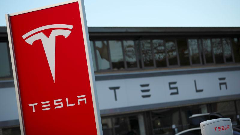 photo image Tesla emails show automaker offered cash to quiet discrimination suit