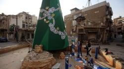 FOTOS: Pese a los escombros, ciudad siria pone su árbol de Navidad y