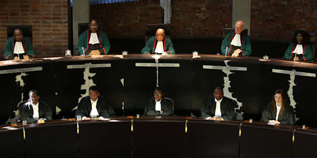South Africa's Chief Justice Mogoeng Mogoeng (Top, C) looks on with other judges before making a ruling at the Constitutional Court in Johannesburg, South Africa. June 22, 2017.  REUTERS/Siphiwe Sibeko