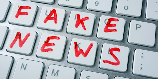 Words fake news written on a keyboard.
