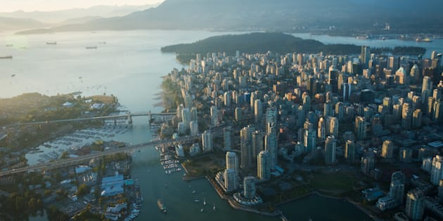 An aerial image of Vancouver, showing Stanley Park, downtown, Granville Bridge, Burrard Street Bridge and the waterfront.