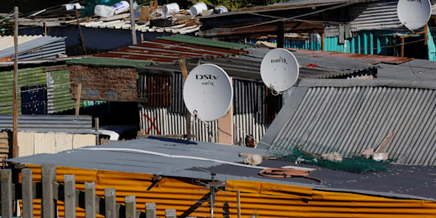 Satellite dishes connect township residents to South Africa's DSTV television network, owned by telecommunications giant Naspers, in Khayelitsha township, Cape Town, May 19, 2017.     REUTERS/Mike Hutchings