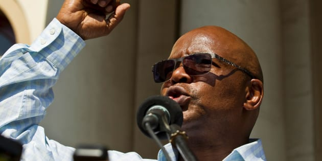 Businessman and chairperson of the Save South Africa (SaveSA) movement Sipho Pityana addresses a crowd of supporters of the SaveSA campaign on April 4, 2017.