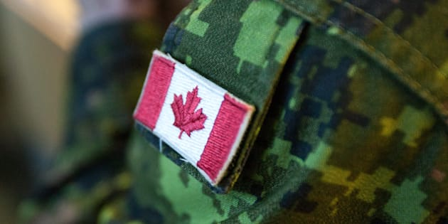 A Canadian flag patch is seen on a soldier's uniform at 426 squadron, CFB Trenton in Trenton, Ont., on Sept. 15, 2012.