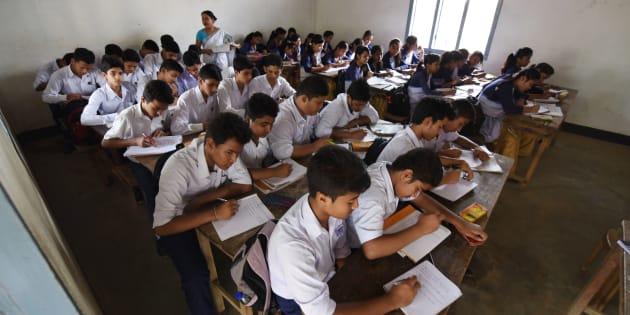 In this photograph taken on June 1, 2016, Indian schoolchildren and teachers take part in lessons in classrooms at Rashtriya Swayamsevak Sangh(RSS)run Sankardev Sishu Nikatan School in the Betkuchi area of Guwahati. / AFP / Biju BORO