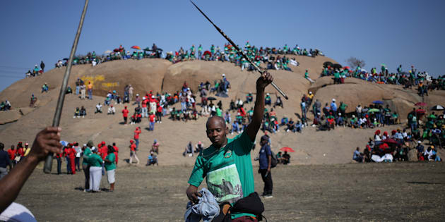 Miners and members of the Association of Mineworkers and Construction Union (AMCU) sing during the 5th-year-anniversary commemorations to mark the killings of 34 striking platinum miners shot dead by police outside the Lonmin's Marikana platinum mine in Rustenburg, South Africa August 16, 2017.