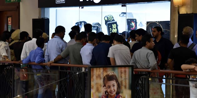 NEW DELHI, INDIA - OCTOBER 7: People standing in queue during the launch of new iPhone 7 at world showroom DLF promenade