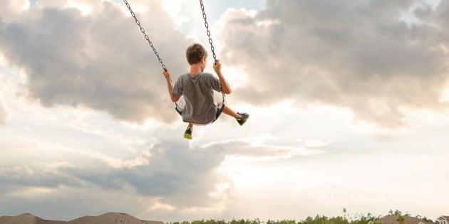 Boy swinging on swing