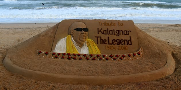 One of a political stalwart M Karunanidhis sand sculpture is seen at the Bay of Bengal Seas eastern coast beach at Puri, 65 km away from the eastern Indian state Odishas capital city Bhubaneswar, on 8 Auguast 2018, as it is creating by sand artist Sudarshan Pattnaik for visitors awareness after his death. (Photo by STR/NurPhoto via Getty Images)