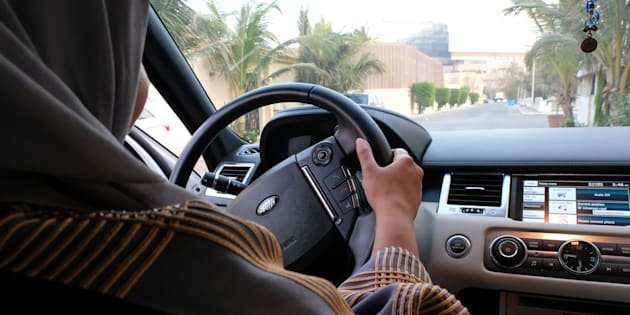 A Saudi woman drives her car in the coastal city of Jeddah on September 27 2017. Saudi Arabia will allow women to drive from June next year.