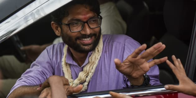 An independent candidate Jignesh Mevani greets people during election campaign on December 10, 2017 in Vadgam, India.