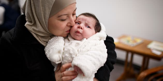 INDIANAPOLIS, IN - FEBRUARY 6: Waed Al-Hamoud, 35, kisses Selena, her 1-month-old daughter, at the Exodus Refugee Immigration offices in Indianapolis, Indiana on Monday, Feb. 6, 2017. In 2014, Al-Hamoud and her family fled Damascus and resettled in Indianapolis. They were the first family to relocate in Indianapolis from war-torn Syria. (Photo by James Brosher for The Washington Post via Getty Images)