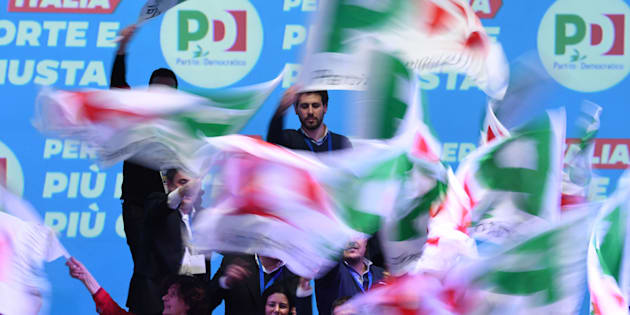Supporters waves flags as former prime minister and head of the centre-left Democratic Party (PD) speaks during the last election campaign meeting in Florence on March 2, 2018. Italy's rival political parties wrap up a bitter campaign on Friday ahead of an election on Sunday in which former prime minister Silvio Berlusconi could once again play a leading role. / AFP PHOTO / Claudio GIOVANNINI        (Photo credit should read CLAUDIO GIOVANNINI/AFP/Getty Images)