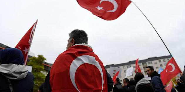 Turkish flags during a protest meeting outside the Bredangsskolan school in southern Stockholm, Sweden, October 15, 2015, following the cancellation of the panel 'July 15th - Behind the Scene of the Bloody Coup' about the July coup attempt in Turkey.    Henrik Montgomery/TT News Agency/via Reuters  ATTENTION EDITORS - THIS IMAGE WAS PROVIDED BY A THIRD PARTY. FOR EDITORIAL USE ONLY. NOT FOR SALE FOR MARKETING OR ADVERTISING CAMPAIGNS. THIS PICTURE IS DISTRIBUTED EXACTLY AS RECEIVED BY REUTERS, AS A SERVICE TO CLIENTS. SWEDEN OUT. NO COMMERCIAL OR EDITORIAL SALES IN SWEDEN. NO COMMERCIAL SALES.