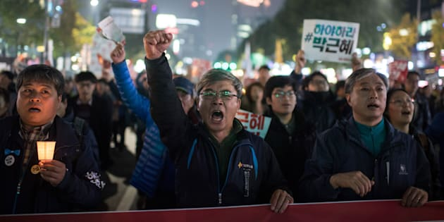 Demonstrators shout slogans during a protest calling for the resignation of South Korean President Park Geun-Hye in central Seoul on November 5, 2016. Thousands of South Koreans took to the streets November 5 to demand embattled President Park Geun-Hye resign over a crippling corruption scandal.  / AFP / Ed JONES        (Photo credit should read ED JONES/AFP/Getty Images)