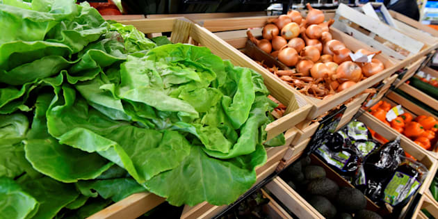 Organic lettuce and onions on sale at an organic supermarket in Saintes, western France, on October 23, 2018. Organic produce doesn't have to suck your budget dry.