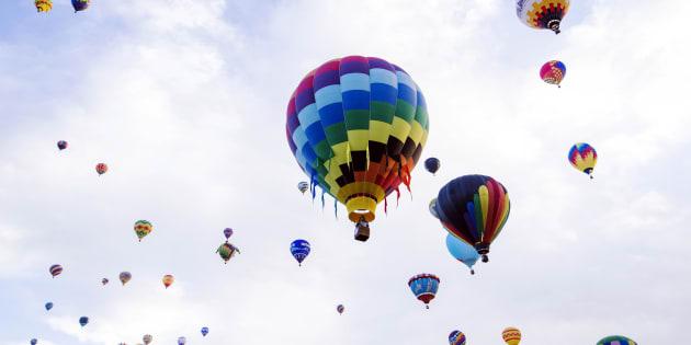 Hot air balloons lift off during the 2015 Albuquerque International Balloon Fiesta in Albuquerque, New Mexico, October 7, 2015.