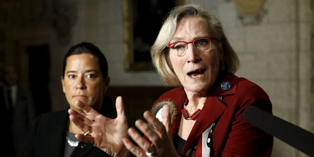 Carolyn Bennett speaks during a news conference on Parliament Hill on Jan. 26, 2016, as Justice Minister Jody Wilson-Raybould looks on.