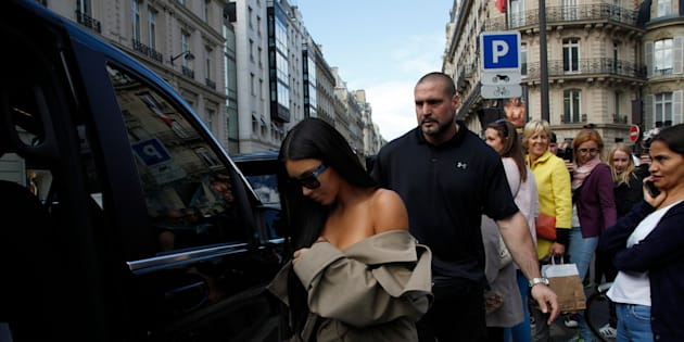 PARIS, FRANCE - OCTOBER 2:  Kim Kardashian West leaves 'L'Avenue' restaurant escoreted by her security Pascal Duvier on October 2, 2016 in Paris, France.  (Photo by Antoine Gyori - Corbis/Corbis via Getty Images)