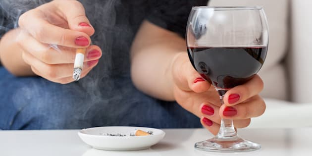 File photo of a woman smoking cigarette and drinking alcohol.