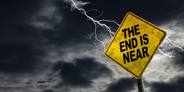 End is Near sign against a stormy background with lightning and copy space. Dirty and angled sign adds to the drama.